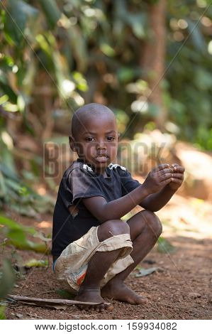 Malagasy Boy In Torn Clothes