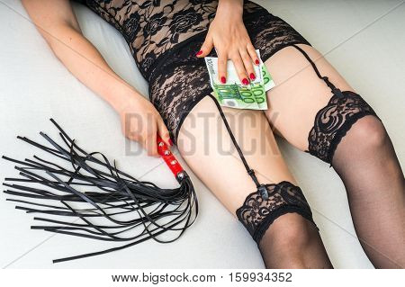 Sexy Woman With Fetish Whip And Money On The Bed