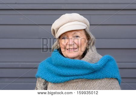 Stylish Elderly Woman In Winter Scarf And Beret