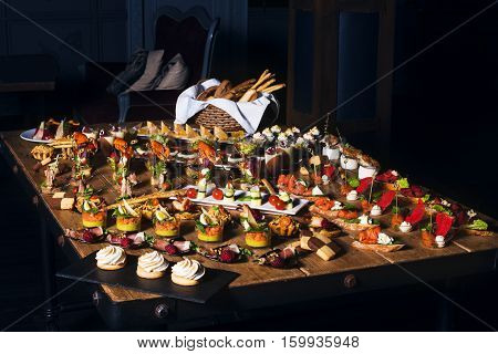 Snacks Set. Brushettas, Canapes, Salads, Desserts, Tartlets, Oysters