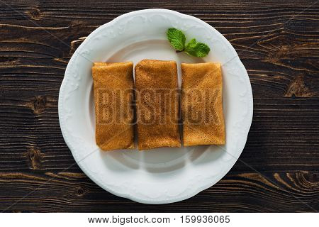 Pancakes With Condensed Milk On A Plate