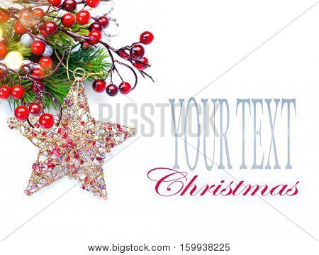 Christmas and New Year Decoration isolated on white background. Border art design with holiday baubles. Beautiful Christmas tree closeup decorated with star, holly berry, tinsel. Space for your text.