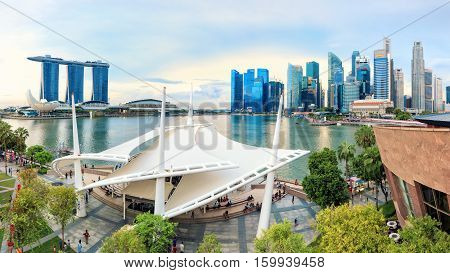 Singapore, Republic of Singapore - May 7, 2016: panorama of Marina Bay with Esplanade theatre outdoor stage on foreground.