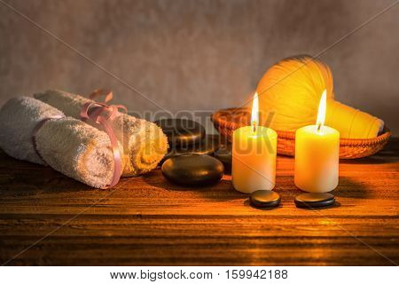 Spa Composition Of White Towels, Candles With Natural Light, Thai Herbal Compress Ball In Basket And