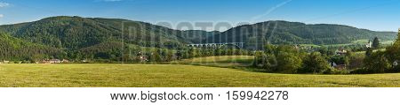 Large panorama landscape with hills. Meadows near the village of Dolni Loucky in Czech Republic. Look to your landscape with the railway bridge.