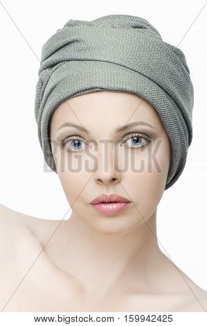 Portrait Of Beautiful Young Woman With A Scarf On Her Head..