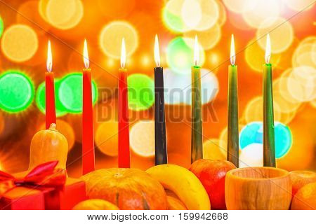 African Kwanzaa Festive Concept With Decorate Seven Candles Red, Black And Green, Gift Box, Pumpkin,