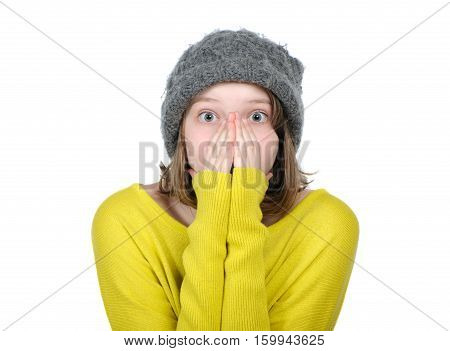 Portrait Of Pretty Frightened Girl Covering Her Face..