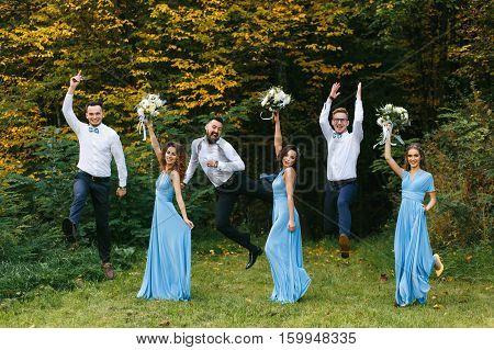 Groomsmen and bridesmaids having fun on wedding ceremony