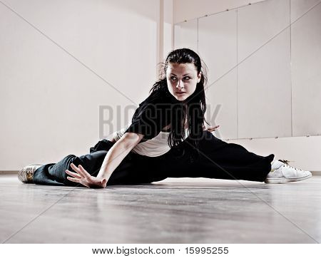 hip-hop girl in dance motion. photo in dance studio poster