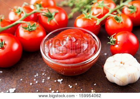Tomato Ketchup Sauce With Garlic, Spices And Herbs With Cherry Tomatoes In A Glass Bowl, Selective F