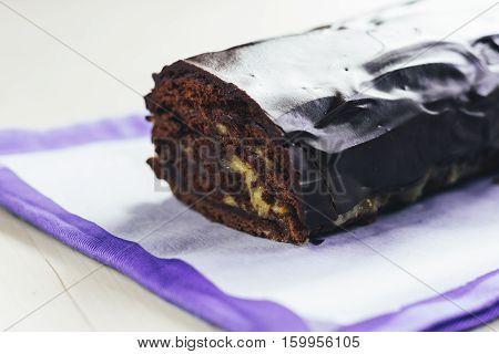 Chocolate Roulade With Lemon Kurd Watered Dark Chocolate