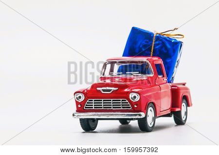 Red Retro Car Pickup With A Blue Gift Box Isolated