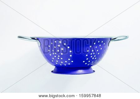 Old blue metal a colander sieve isolated