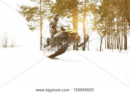 The sportsman on a snowmobile. Recreation concept on nature in winter and New Year holidays. Winter sports.