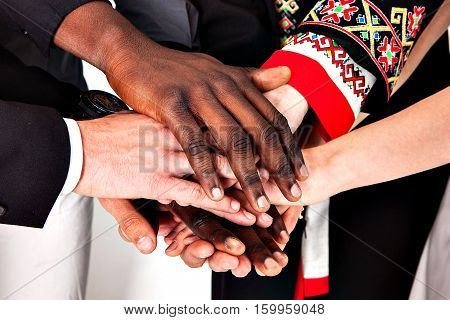 People of different nationalities together. The concept of network, union, community, communication. Different people shaking hands. Different people.