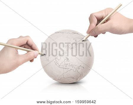 Two hand stroke drawing Asia map on paper ball on white background