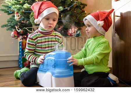 Two Adorable Boys Playing With Working Humidifier, Waiting For X-mas