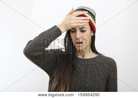 Young frustrated hipster girl with hat forget something