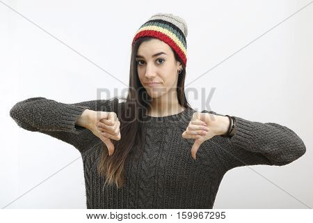 Young hipster woman is showing thumb down