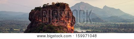 Sunset over the Lion Rock in Sigiriya Sri Lanka. Aerial view of the tropical forest with mountains