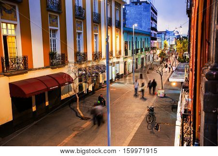 Mexico City is the capital of Mexico. Nightlife in Mexico City. Streets of the center with blurred people bars restaurants and cafes.