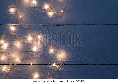 Garland on empty wooden floor