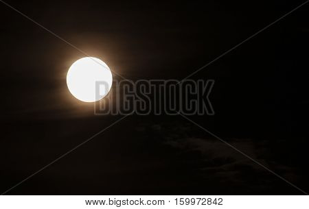 Super bright full moon on the night sky. No details on the moon on purpose.
