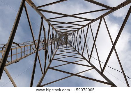 Metallic structure of a telecommunication tower holding antennas for TV and radio transmission at the top