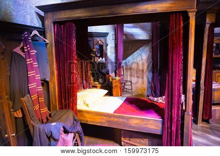 Leavesden, London, UK - 1 March 2016: Interior of student's bedroom. Harry Potter's bed. Decoration Warner Brothers Studio