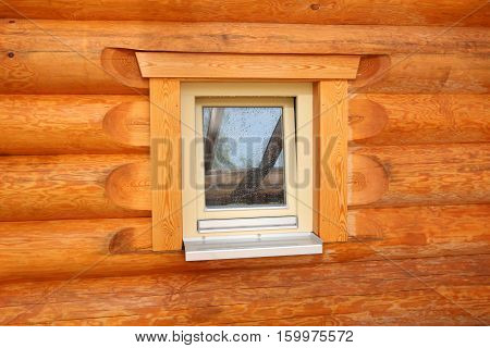 Log cabin home / Wall of house from logs / Window