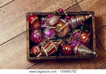 Old rough hewn wooden box with folded Vintage Christmas Toys