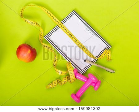 Weekly planner and sport equipment for weight loss
