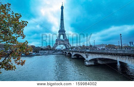 Paris France - November 18 2014: The Eiffel Tower vire from Pont Iena in cloudy fall day on November 18 2014. The Eiffel Tower is one of the most visited place in the World