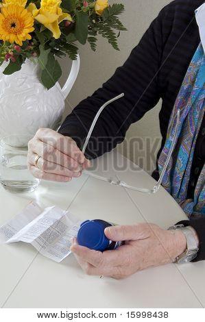 Senior woman taking medication