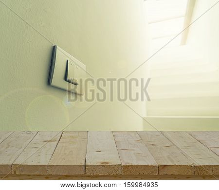 abstract wood table top and lighting switch on wall with lens fare filter - can use to display or montage on product