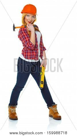 Young woman in helmet with the work tools on a white background
