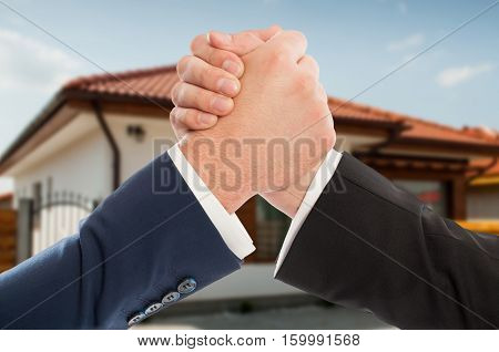 Male Estate Brokers Shaking Hands
