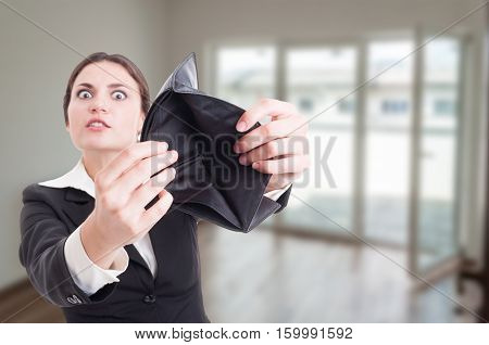 Real Estate Consultant Showing Empty Wallet