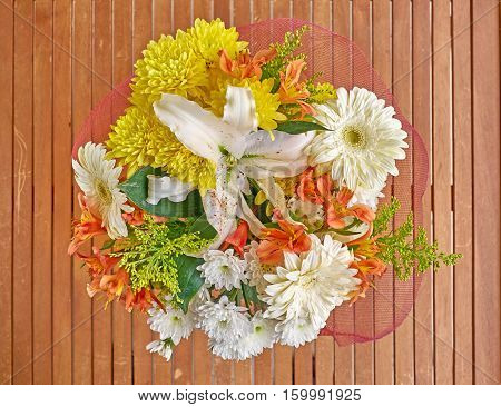 colorful flowers bouquet on grunge wooden background