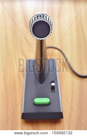 Old fashioned microphone on desk, elevated view, focus on foreground