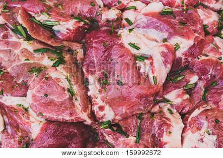 Raw Pork Neck Chops Meat With Spices Ready For Barbecue.