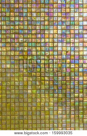 yellow nacreous mosaic colorful background on the wall