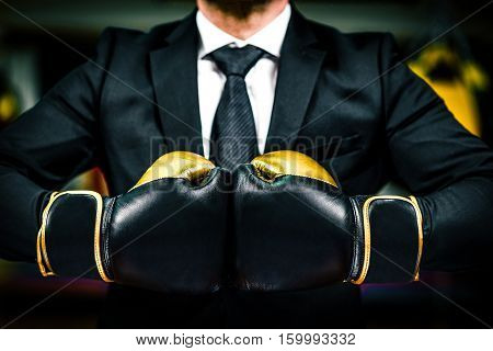 Businessman With Boxing Gloves Is Ready For Corporate Battle.