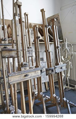 View of group of easels in empty artist's studio