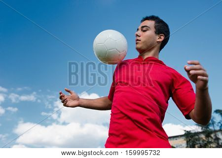 Soccer player handling the ball, toned image