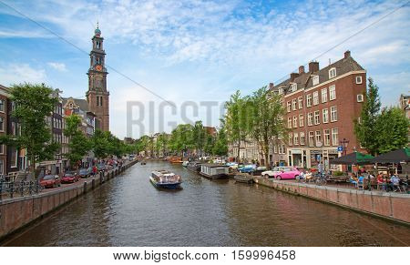 AMSTERDAM - JULY 10: Canals of the Amsterdam city on July 10, 2016 in Amsterdam, Netherlands. The canals of the city surrounded by traditional dutch houses is one of the main attractions of Amsterdam.