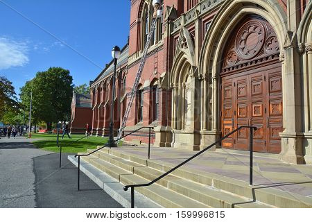 CAMBRIDGE USA - OCTOBER 20 2014: Harvard Memorial Hall doors. Harvard is the most prestigious and oldest university in United States