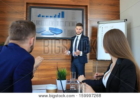 Business training at office business man presenting successful financial numbers on screen of plasma TV at meeting room