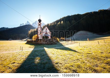 Morning in St. Magdalena village. Gorgeous scene. Location famous place San Giovanni Church, Funes Valley (Villnob), Odle Group mountains, Dolomites. Province of Bolzano - South Tyrol, Italy. Europe.
